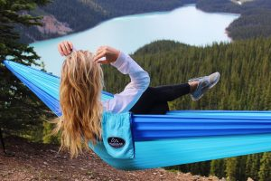 Azul Madera Hammocks Blue with women sitting inside