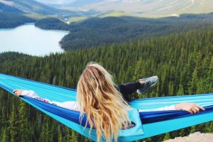 Azul Madera Hammocks Blue with women sitting inside over valley